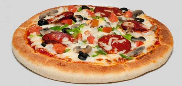 صورة طريقة عمل عجينة بيتزا هشة