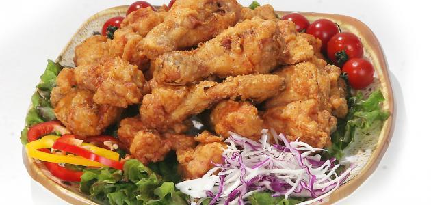 صورة كيفية تتبيل الدجاج المقلي