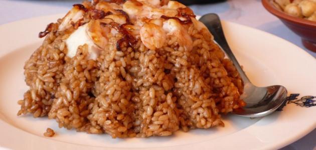 صورة طريقة عمل أرز السمك البني