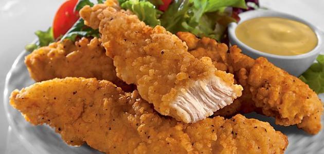 صورة طريقة قلي الدجاج بالبقسماط