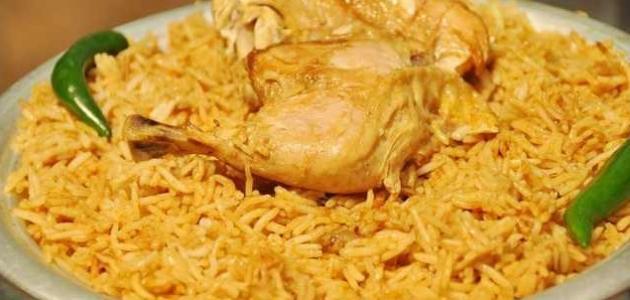صورة طريقة عمل أرز مضغوط بالدجاج
